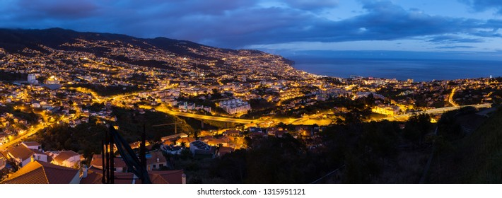 Beautiful 180 degree panoramic cityscape panorama of the city Funchal, on the island Madeira at night in summer