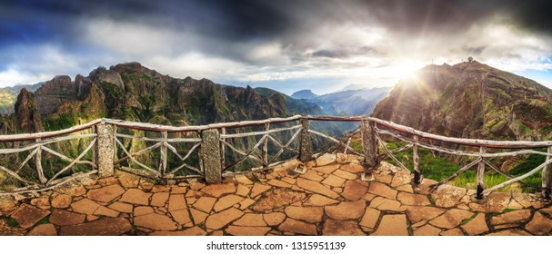 Beautiful 180 degree panoramic landscape panorama of the mountains of Madeira on a cloudy summer day from the Buzzard's nest viewpoint, while hiking from Pico do Arieiro to Pico Ruivo