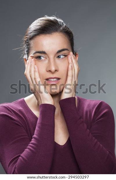 beautiful 30's woman smiling in lifting her eyes with hands for anti-aging eye care