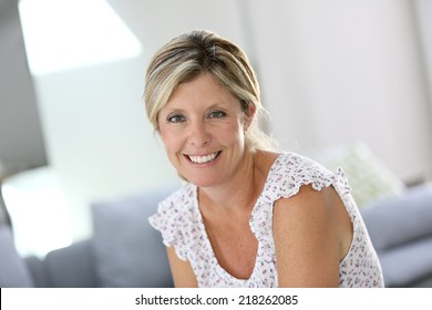 Beautiful 40-year old woman at home