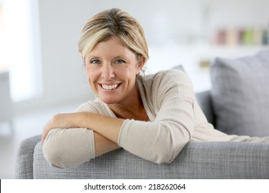 Beautiful 40-year-old woman relaxing in sofa