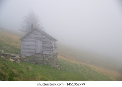 A beautiful abandoned hut in the fog on a mountain in Norway.