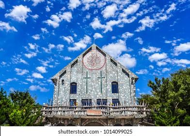 Beautiful Aboriginal Church Under Blue Sky and  Cotton Cloud in the Mountain Village of Hsinchu, Taiwan