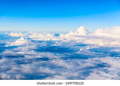Beautiful above sky panoramic view from airplane. Skyline background panorama.
