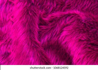 Beautiful abstract art background of detail bright colorful pattern texture shaggy fur with long fibers. Polyester synthetic or natural fluffy plaid. Comfortable home textile. Closeup palette texture