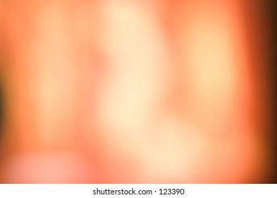 Beautiful abstract background in orange and peach colors of light.