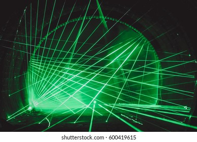 beautiful abstract green laser beams in the darkness