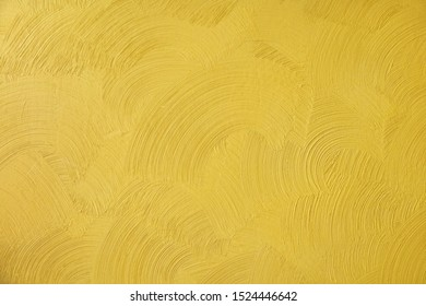 Beautiful Abstract Grunge Decorative Golden Stucco Wall Background. Art Rough Texture Banner With Space For Text. Pattern closeup