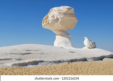 Beautiful abstract nature rock formations aka sculptures Chicken and Mushroom at sunset in Western White desert, Sahara. Egypt