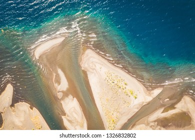 Beautiful abstract patterns on the sand and ocean looked from above