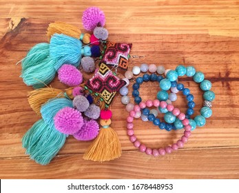 Beautiful accessories colorful handmade tribal fashion earring and natural stone bracelet on wooden background