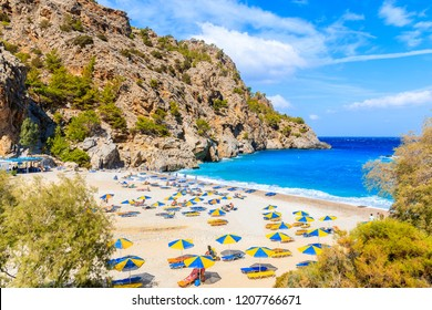 Beautiful Achata beach with colorful umbrellas and sunbeds, Karpathos island, Greece