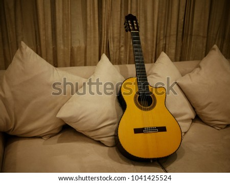 Beautiful Acoustic Guitar On White Sofa Stock Photo Edit Now