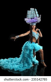 beautiful, active dancer in a lush, gorgeous dance costumes. dance movements, artistic emotions