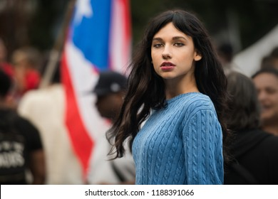 Beautiful activist woman protesting on city street rally