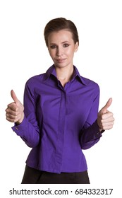 A beautiful, adult, business woman is holding her fingers up. Purple shirt. White background