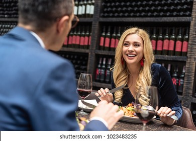 beautiful adult couple having romantic dinner at restaurant