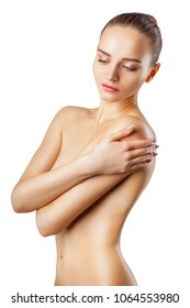 Beautiful adult slim woman covers her bare breasts. Isolated on white background