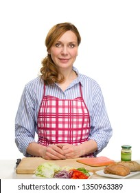 Beautiful Adult Woman Cooking in the kitchen.