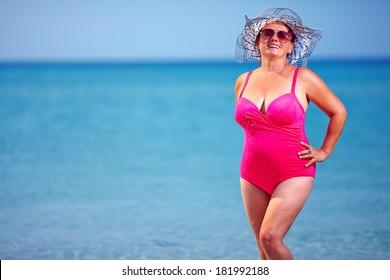 beautiful adult woman on summer beach