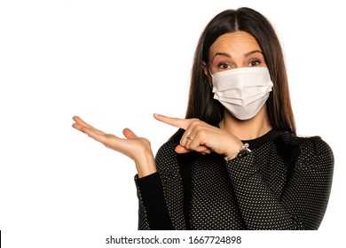 Beautiful advertizing young woman with protective mask on her face on white background
