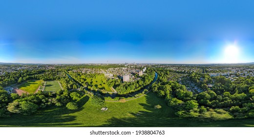 Beautiful aerial 360 Panorama view on european finance center city Frankfurt am Main downtown skyline from park Niddapark, Nidda river in spring. Blue sky, clouds, green trees. Hesse, Germany.