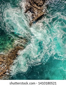 Beautiful aerial birds eye view on ocean waves, Fuerteventura island. Aerial shooting seascape coastline at sunny day. Travell, Beach,islands, Nature, freedom concept.
