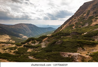 Beautiful aerial drone photo of mountain landscape in Carpathian natural park.High rocky mountains in Southern Europe.Travel destination for active tourism.Go hiking in Carpathians
