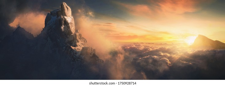 Beautiful aerial landscape of mountain peak at sunset above the clouds - panoramic - Shutterstock ID 1750928714