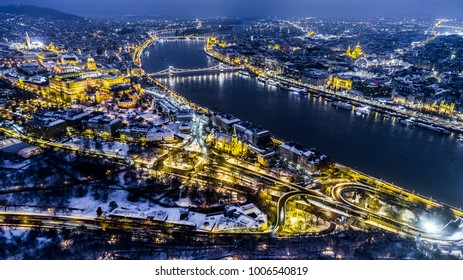Beautiful aerial night shot about a big town with bridges in winter time