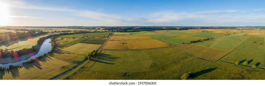 Beautiful aerial panorama of green agricultural fields at sunset in Australia. - Shutterstock ID 1937006305