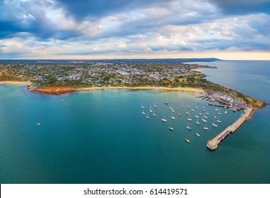Beautiful aerial panorama of Mornington Peninsula coastline and Mornington Pier at sunset. Melbourne, Victoria, Australia