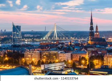 Beautiful aerial panorama of Riga center and Vansu bridge over Daugava river during amazing sunset. View of illuminated Riga city, capital of Latvia.
