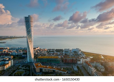 Beautiful aerial panoramic view of the Malmo city in Sweden by the sea with the Oresund bridge visible on the horizon.