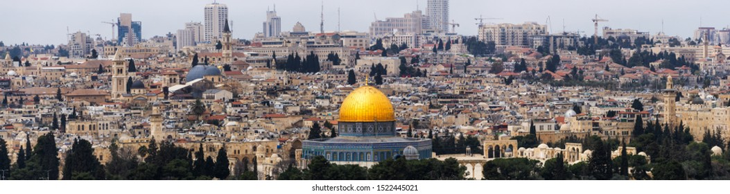 Beautiful Aerial Panoramic view of the Old City and Dome of the Rock during a sunny and cloudy day. Taken in Jerusalem, Capital of Israel.