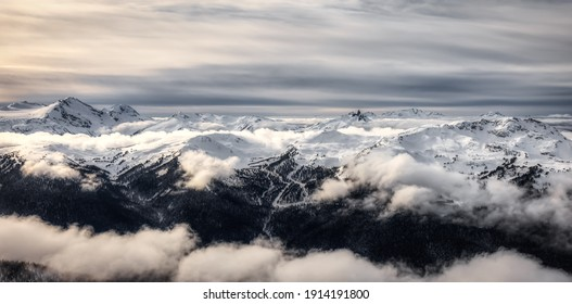Beautiful Aerial Panoramic View of Whistler Mountain during a sunny winter day. Taken from Blackcomb Peak, Whistler, British Columbia, Canada. Canadian Nature Landscape Panorama