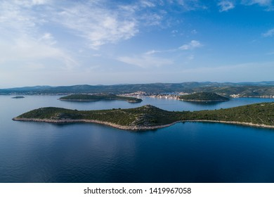 Beautiful aerial photo of Rogoznica Dalmatia, Croatia. Nice nature and landscape on summer evening at Adriatic Sea and coast. Lovely seascape and outdoors shoot with drone from above at sunset.