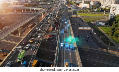 Beautiful aerial presentation of the autonomous cars self-driving concept on multi-level highway in Moscow. Picturesque aerial panorama of the road traffic in a big city on the evening.