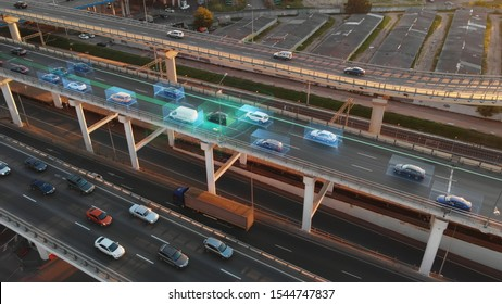 Beautiful aerial presentation of self-driving cars concept on multi-level highway in Moscow. Picturesque aerial panorama of autonomous cars in the road traffic of big city on the evening.