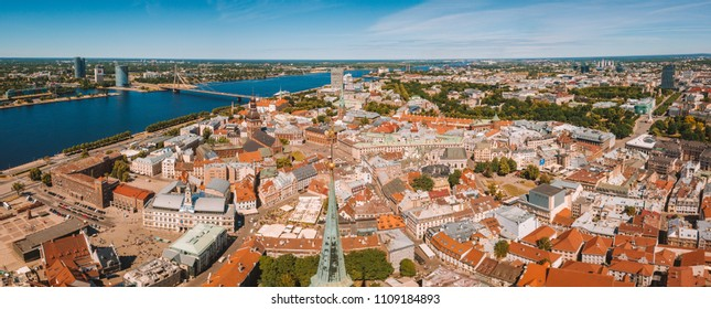 Beautiful aerial Riga view from above with golden rooster on the top of the St. Peters church and old town of Vecriga.