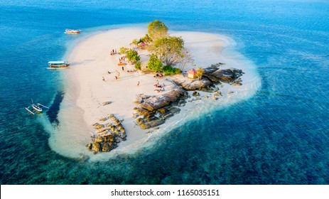Beautiful aerial scenery of Giri Kedis island with aquamarine water in Lombok, Indonesia