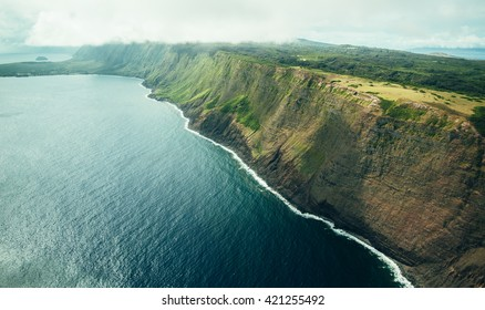 Beautiful Aerial Scenic View Photo of Molokai Sea Cliffs From The Air with Deep Blue Ocean Water Below in Tropical Island Paradise in Hawaii