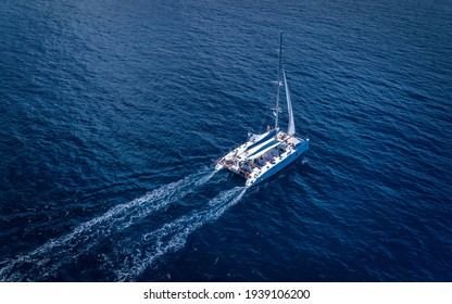 Beautiful Aerial shot of yacht cruise at sea in Ibiza Spain VIP luxury