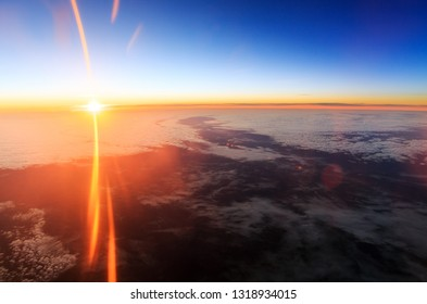 Beautiful aerial sunrise cloudscape with a blue morning sky and bright summer sun in the Netherlands