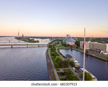 Beautiful aerial sunset view over AB dam in Riga Latvia with a huge Latvian flag
