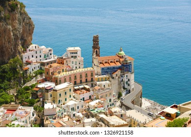 Beautiful aerial view of Atrani village between green branches and cliff rocks, Amalfi Coast, Italy