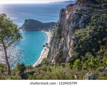 Beautiful aerial view of Baia dei Saraceni with blue Mediterranean sea and a stone watchtower near Varigotti, quaint fisherman village near Finale Ligure, Savona, Liguria, Italy, Italian Riviera
