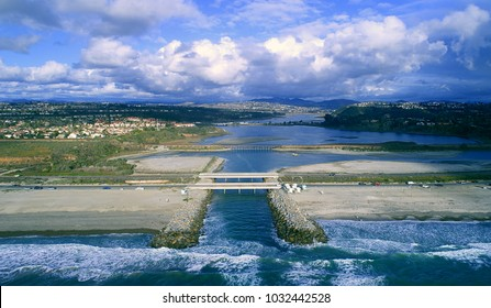 A beautiful, aerial view of batiquitos lagoon, Carlsbad beach, cloudscape, waves, reflections, and more in San Diego county California