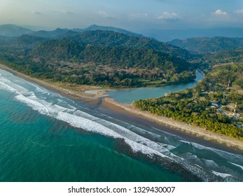 Beautiful aerial view of the Beach in Dominical  and the Baru River in Costa Rica