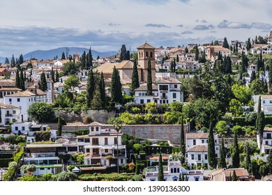 Beautiful aerial view city of Granada in a daytime. Granada - capital city of province of Granada, located at foot of Sierra Nevada Mountains. Granada, Andalusia, Spain.